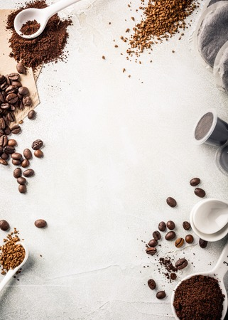 Background with assorted coffee, coffee beans, ground and instant, pads and capsules, retro style toned, copy space, top view.