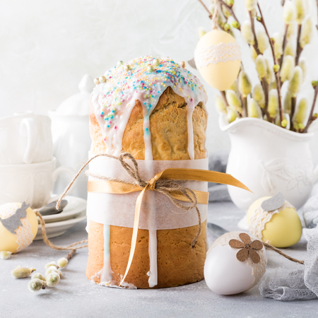 pussy: Easter composition with orthodox sweet bread, kulich and eggs on light background. Easter holidays breakfast concept. Stock Photo