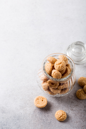 amaretto: Amaretti cookies in glass pot on light gray background with copy space. High angle view Stock Photo
