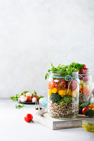 Homemade salad in glass jar with quinoa and vegetables. Healthy food, diet, detox, clean eating and vegetarian concept with copy space. Stock Photo
