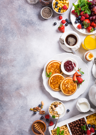 caffeine free: Healthy breakfast background with homemade pancakes and fresh berries, copy space, top view. Stock Photo