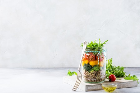 Homemade salad in glass jar with quinoa and vegetables. Healthy food, diet, detox, clean eating and vegetarian concept with copy space. Stock fotó