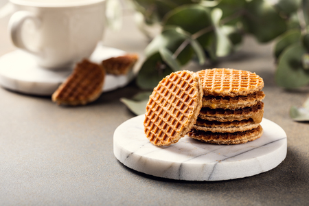 Syrupwaffles cookies and cup of tea