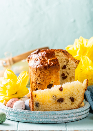 Slice of easter orthodox sweet bread, kulich end quail eggs.