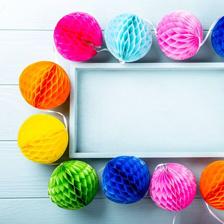 Festive background with colorful paper balls.