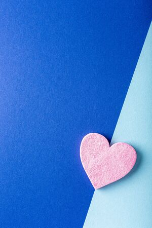 Valentine's Day background. Pink heart over blue. Valentines day concept. Flat lay, top view, copy space