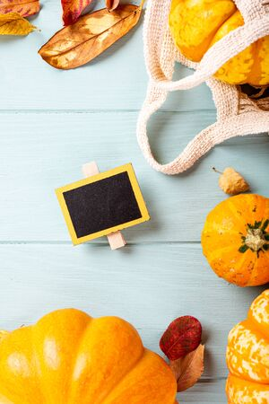 Autumn pumpkin thanksgiving background, assorted pumpkins over blue turquoise wooden table. Halloween flat lay with copy space. Top view. Banque d'images