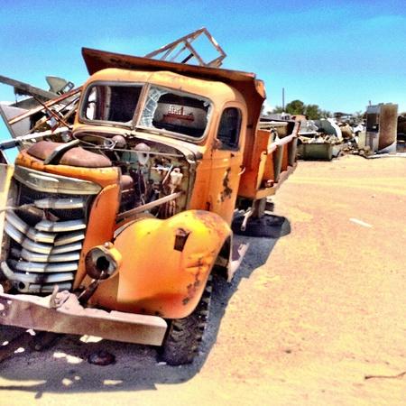Vintage truck wreck in the desert.