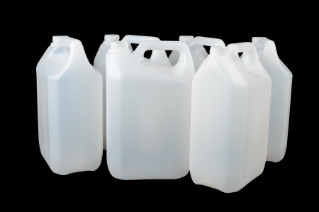 White plastic food grade container isolated on black  Often used for water, alcohol or other liquids Stock Photo - 22900300