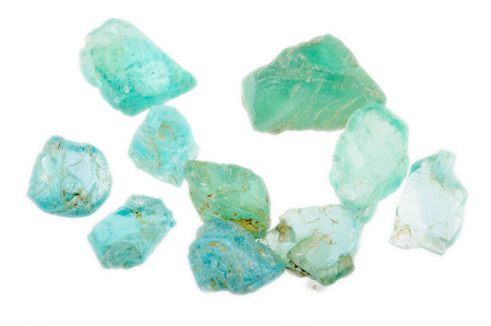 Rough and uncut pile of Apatite gemstones in a lovely blueish green color