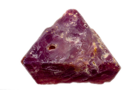 lapidary: A dark red, slightly violet rough and uncut natural Spinel crystal  Triangular crystal shape