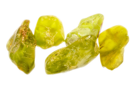 Bright green uncut and rough Peridot or Olivine, as it is also called