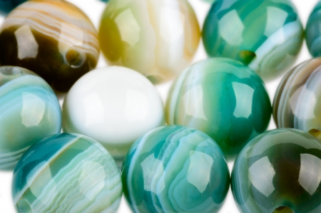 gemological: Round Agate beads in blue, green and Brown with nice patterns and polish   Stock Photo