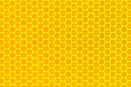 Detail of yellow orange reflex tape. Honeycomb pattern. photo