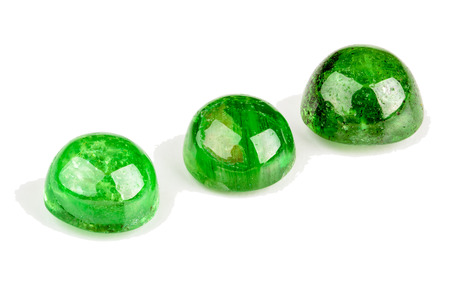 tsavorite: Three Tsavorite garnet cabochons in green Stock Photo