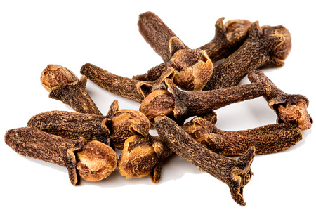 Cloves are the aromatic dried flower buds of a tree  Macro of pile  Stock Photo