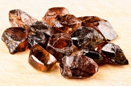 hardness: Natural brown Zircon crystals on wooden board  Stock Photo