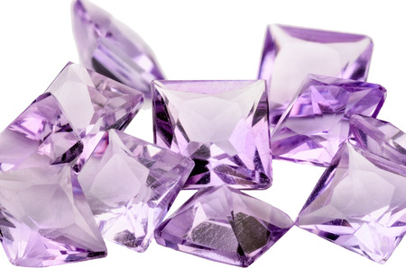 A pile of violet princess cut Amethysts photo