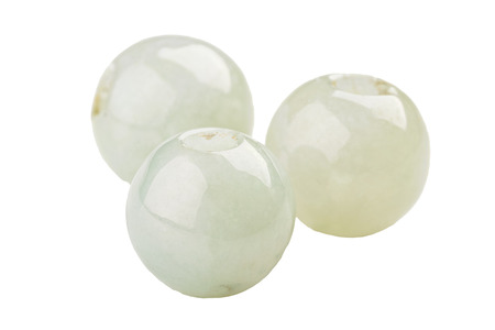 Three round beads of light green Jadeite