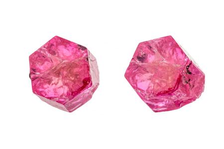 beryl: Raw uncut crystal of gem often called red beryl, red emerald, or bixbite