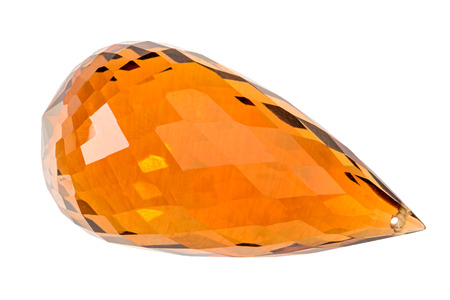 One brighly orange Citrine briolette on white
