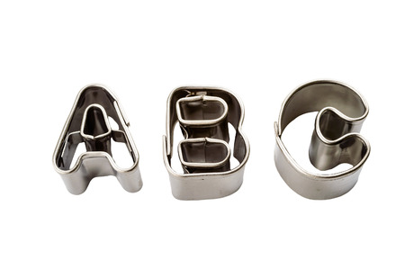 Letters a b c baking tins isolated on white Stock Photo - 24388870
