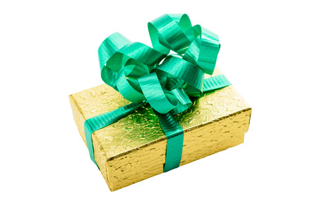 Golden gift box with green bow and ribbon isolated on white photo