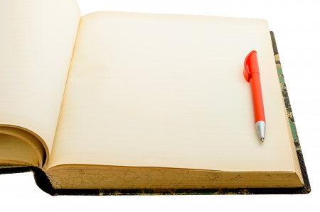 Old yellowing empty book with red pen isolated on white photo