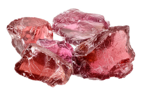 A pile of purple red rhodolite garnet gemstone crystals uncut, rough  Isolated on white Stock Photo