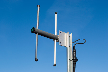 aluminum rod: Antenna against blue sky. Black kable and connector.