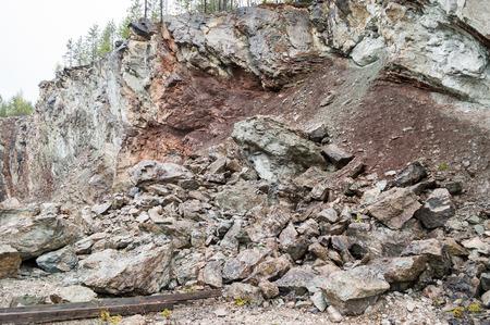 sedimentation: Old limestone quarry with vertical layered sedimentation. Vertical layers caused by meteorit impact 377 miljon years ago. Stock Photo