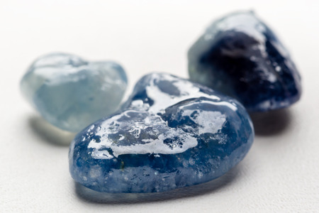 uncut: Raw, uncut and rough sapphire gemstone. Stock Photo