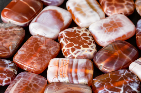 Rounded orange rectangular fire agate beads.
