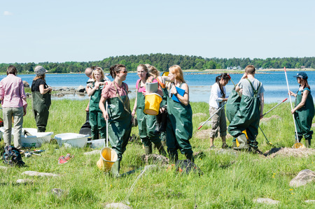 waders: KALMAR, SWEDEN - MAY 26: Female students on ecology, biology field trip to study marine life.