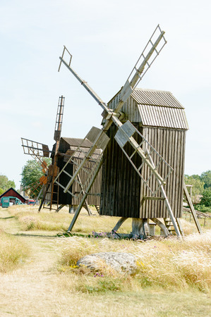 oland: Old wooden windmill, post mill, against blue sky in summer.
