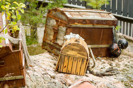 net income: Open treasure trunk or chest with debris and junk from the sea. Stock Photo