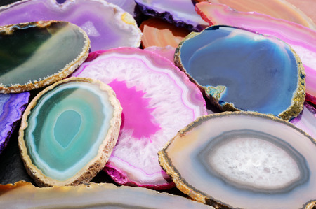 zoned: Several slices of dyed geodes in colorful pile.