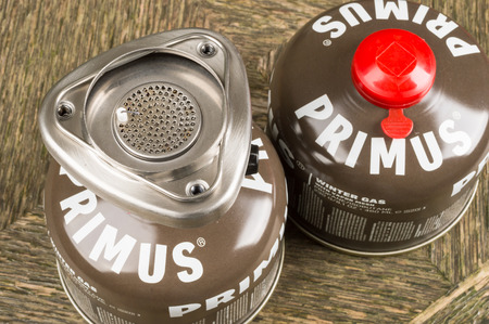 primus: JOHANNISHUS, SWEDEN - DECEMBER 09, 2014: Primus brown winter gas canister with red lid and burner with piezo igniter on top. Editorial