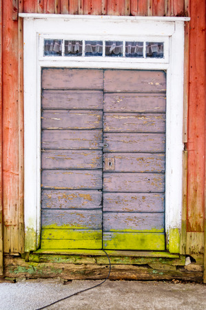 Old weathered door with fine colors and lock. photo