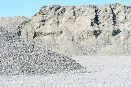 sorted: Big pile of sorted granite gravel in gravel pit.