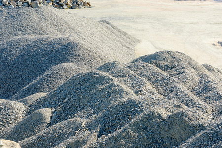 gravel pit: Big pile of sorted granite gravel in gravel pit.