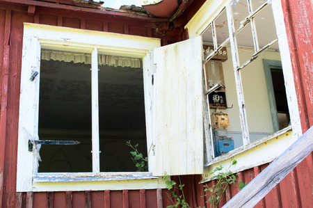 dwelling: Broken windows on abandoned house. Electric installations visible in room. Stock Photo
