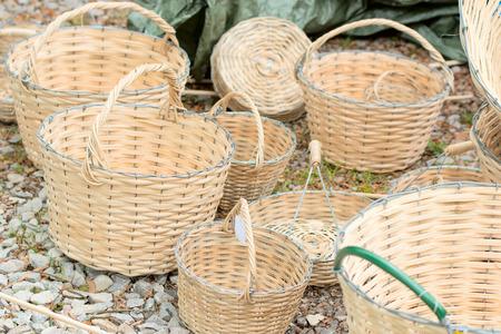 storage bin: An assortment of handmade baskets on the ground. Stock Photo