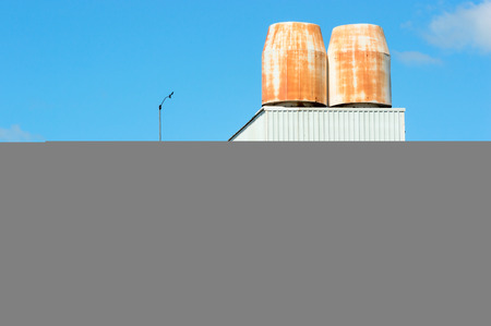 Large air ventilation on roof top of industrial building. Blue sky in background. photo