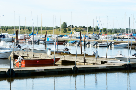 pollution free: Listerby, Sweden - June 17, 2015: Marina is filling up with different boats as the summer is progressing. Spending time on the sea is a growing leisure pursuit in Sweden.