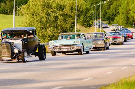 thunderbird: Ronneby, Sweden - June 26, 2015: Veteran car street cruise on public roads. Ford thunderbird 1960 green in caravan.