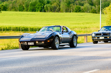 corvette: Ronneby, Sweden - June 26, 2015: Veteran car street cruise on public roads. Dark blue Chevrolet Corvette 1974. Editorial