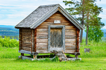 storeroom: Old wooden storage building from northern Sweden. Building stands on timber above ground to stop pest animals from entering.