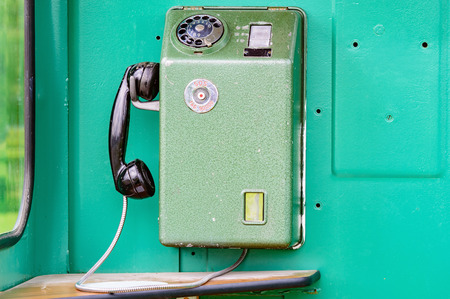 telephone booth: An old telephone from inside a telephone booth from the 1970s. The mobile phone of the old age. This is a Swedish model with the old emergency or SOS number.