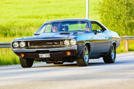 challenger: Ronneby, Sweden - June 26, 2015: Veteran car street cruise on public roads. Dodge challenger 1970 black